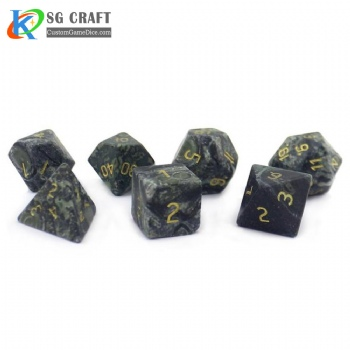 Natural green eyed stone dice set